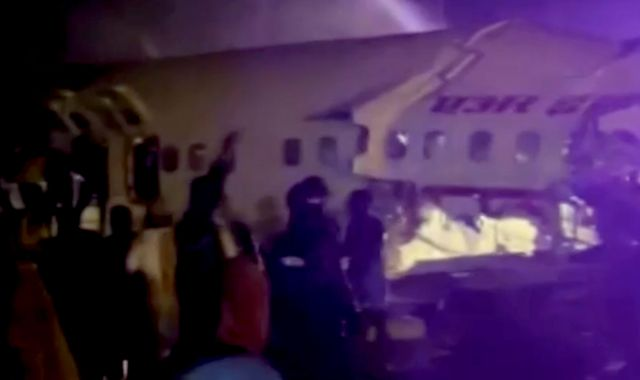 Kerala plane crash: At least 14 dead and several injured as aircraft 'splits in two' at airport