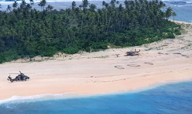 'SOS' message in sand saves three men stranded on deserted Pacific island
