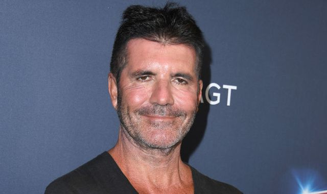Simon Cowell breaks his back while testing electric bicycle