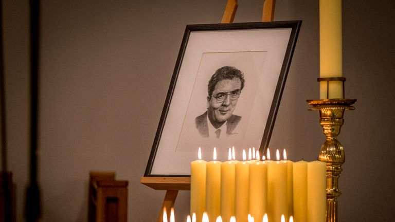 A portrait of John Hume surrounded by candels lit by members of his family and colleagues in St Eugene's Cathedral, Londonderry ahead of his funeral on Wednesday.