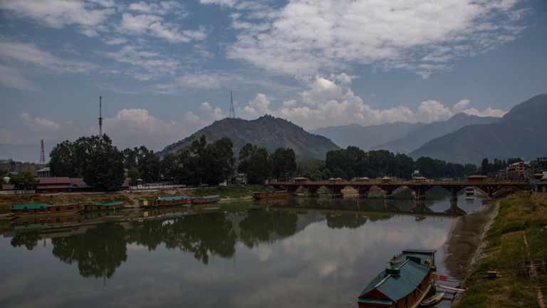 SRINAGAR, KASHMIR - INDIA - AUGUST 05: House boats are moored to the banks of river Jehlum, a year after India revoked the special status of Jammu and Kashmir, in the city center  on August 05, 2020  in Srinagar, the summer capital of Indian administered Kashmir, India. Indian police and paramilitary personnel were deployed in strength as authorities imposed curfew-like restrictions in summer capital city Srinagar  on the first anniversary of the Indian government stripping the Himalayan region, contested by both India and Pakistan since 1947, of its autonomy and downgrading its status from a state to a union  territory in a stealth move last year. The region is already reeling under a lockdown imposed by authorities to curb the spread of coronavirus. (Photo by Yawar Nazir/Getty Images)