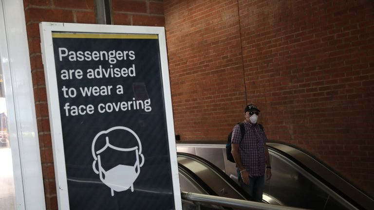 LONDON, ENGLAND - MAY 18: A commuter wears a protective face mask at Waterloo station on May 18, 2020 in London, England. The British government has started easing the lockdown it imposed two months ago to curb the spread of Covid-19, abandoning its 'stay at home' slogan in favour of a message to 'be alert', but UK countries have varied in their approaches to relaxing quarantine measures. (Photo by Dan Kitwood/Getty Images)