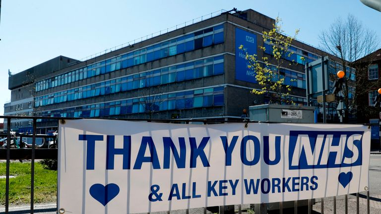 A message of thanks to the NHS (National Health Servce) is pictured attached to railings outside Watford General Hospital in north west London on April 5, 2020, as life in Britain continues during the nationwide lockdown to combat the novel coronavirus pandemic. - Watford General hospital declared a critical incident on Saturday, telling people not to attend after an issue with their oxygen supplies. On Sunday reports confirmed that John Alagos, a 23-year-old nurse who treated coronavirus patients at the hospital, died after a shift on Friday. (Photo by Adrian DENNIS / AFP) (Photo by ADRIAN DENNIS/AFP via Getty Images)