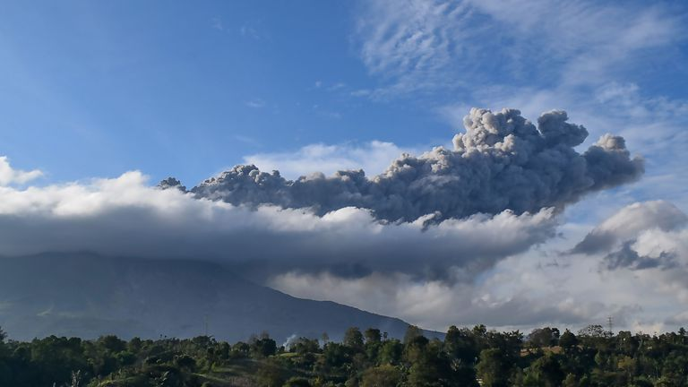TOPSHOT - Sinabung volcano spews ash during its second eruption toward dusk as seen from Karo district, North Sumatra, on August 8, 2020. (Photo by ANTO SEMBIRING / AFP) (Photo by ANTO SEMBIRING/AFP via Getty Images)