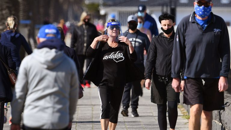 People exercise along Port Melbourne Beach in Melbourne on August 10, 2020, as the city struggles to cope with a COVID-19 coronavirus outbreak. (Photo by William WEST / AFP) (Photo by WILLIAM WEST/AFP via Getty Images)