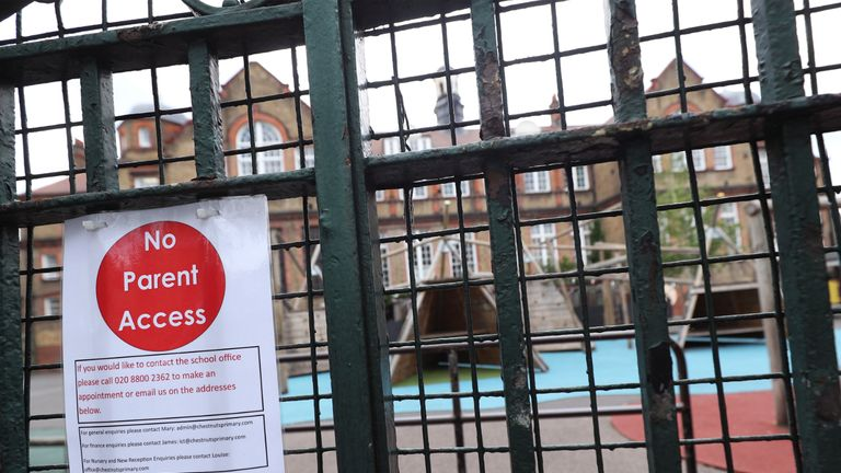 A sign saying 'no parent access' on a primary school gate in London, following the introduction of measures to bring England out of lockdown.