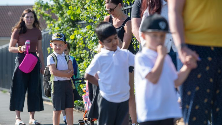 Parents drop off pupils at Queen's Hill Primary School, Costessey, Norfolk, as pupils in Reception, Year 1 and Year 6, begin to return to school as part of a wider easing of lockdown measures in England.