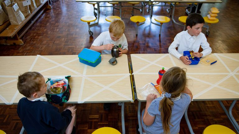 File photo dated 18/05/20 of children eating lunch in segregated positions at Kempsey Primary School in Worcester. Primary schools in England will reopen to more pupils from June 1, the Prime Minister has confirmed.