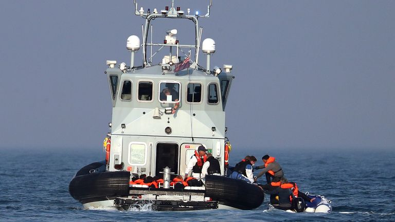 Border Force officers assist 20 Syrian migrants aboard HMC Hunter after they were stopped as they crossed The Channel in an inflatable dinghy headed in the direction of England.