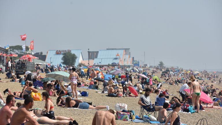 SOUTHEND-ON-SEA, ENGLAND AUGUST 11: People sunbathe on the beach during the recent hot weather on August 11, 2020 in Southend on Sea, England. Parts of the UK remain in the grip of a Summer heatwave that has seen temperatures rise above 30 degrees in much of the country. (Photo by John Keeble/Getty Images)