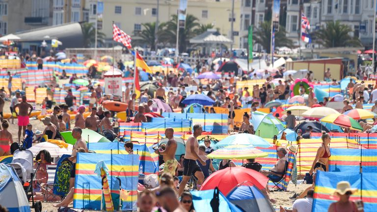 WEYMOUTH, ENGLAND - AUGUST 09: Tourists enjoy the hot weather on the beach on August 09, 2020 in Weymouth, England. (Photo by Finnbarr Webster/Getty Images)