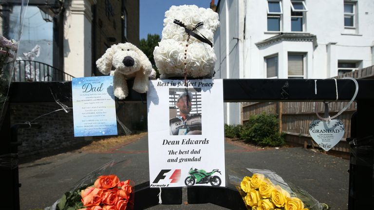 Tributes near the scene of Dean Edwards' murder in Betts Park, south London, as police renew an appeal for information. Edwards, 43, was shot in the back of the head while leaving Betts Park in Penge in July.