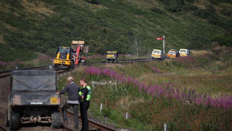 Emergency vehicles at Carmont crossing, where they are accessing the train line from the road, south of the scene in Stonehaven, Aberdeenshire, where the 06.38 Aberdeen to Stonehaven ScotRail train derailed at about 9.40am this morning. The fire service, police and ambulance service are in attendance and the incident is ongoing.