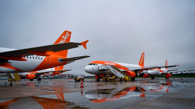 EasyJet lowcost airline aircrafts with their engines covered with plastic protection, remain on the tarmac of the Humberto Delgado airport in Lisbon on April 9, 2020. - Portuguese government decided to suspend all flights from April 9 to 13 to prevent the spread of the coronavirus COVID-19 outbreak. (Photo by PATRICIA DE MELO MOREIRA / AFP) (Photo by PATRICIA DE MELO MOREIRA/AFP via Getty Images)