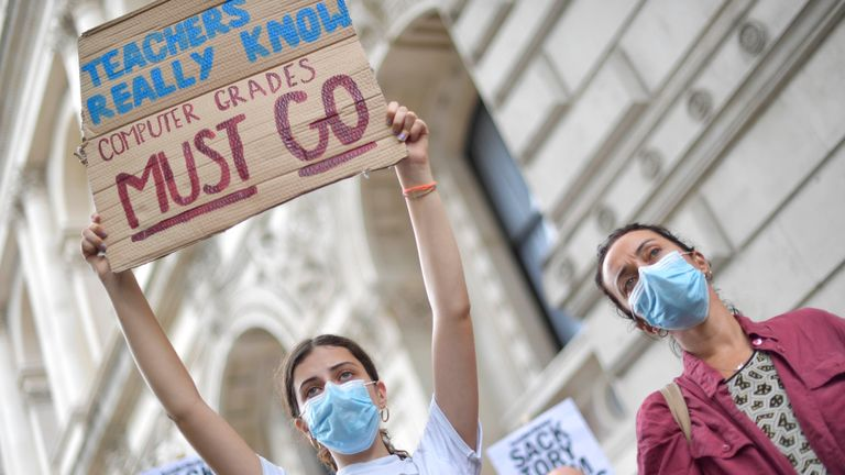 People take part in a protest outside Downing Street in London over the government's handling of A-level results. Thousands of pupils across England have expressed their disappointment at having their results downgraded after exams were cancelled due to coronavirus.
