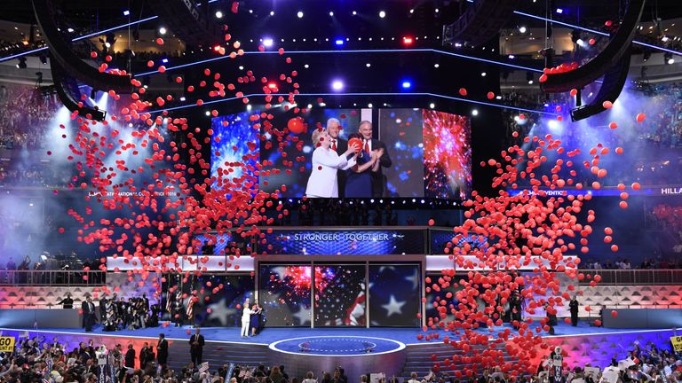Balloons come down on Democratic presidential nominee Hillary Clinton and running mate Tim Kaine at the end of the fourth and final night of the Democratic National Convention at Wells Fargo Center on July 28, 2016 in Philadelphia, Pennsylvania.   / AFP / SAUL LOEB        (Photo credit should read SAUL LOEB/AFP via Getty Images)