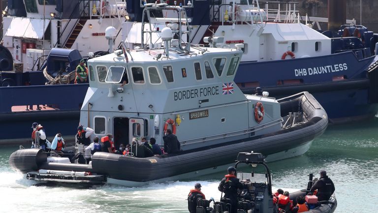 A group of people thought to be migrants are brought into Dover, Kent, by Border Force officers following a number of small boat incidents in the Channel earlier today.