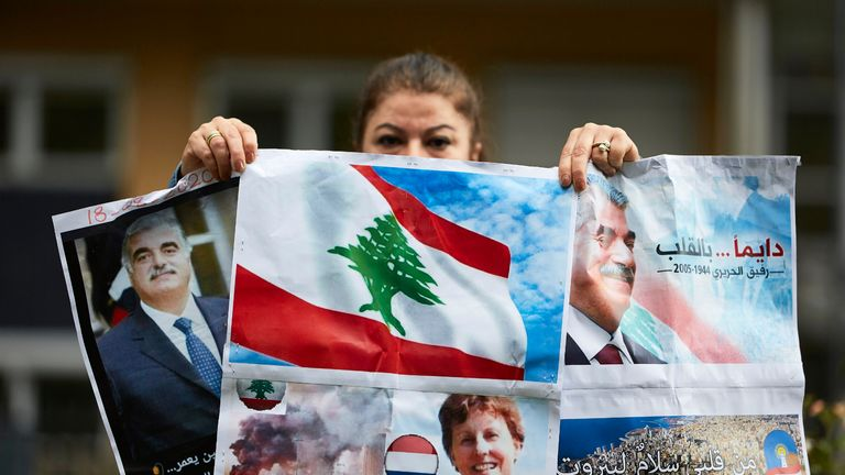 THE HAGUE, NETHERLANDS - AUGUST 18: A supporter of former Prime Minister Rafiq Hariri holds posters outside the Lebanon Tribunal on August 18, 2020 in The Hague, Netherlands. The Special Tribunal for Lebanon must render its verdict on the trial of four men accused of participating in the 2005 assassination of former Lebanese Prime Minister Rafic Hariri. (Photo by Pierre Crom/Getty Images)