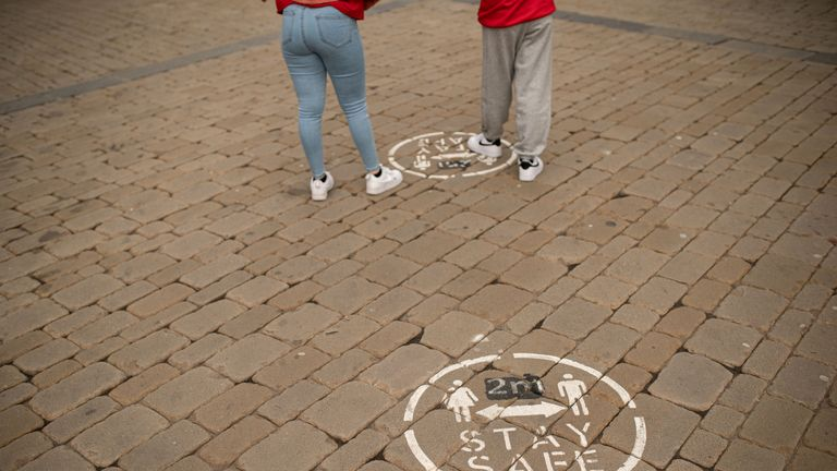 Floor markings advise shoppers to keep their distance in Oldham, greater Manchester, northwest England on July 30, 2020. (Photo by OLI SCARFF / AFP) (Photo by OLI SCARFF/AFP via Getty Images)