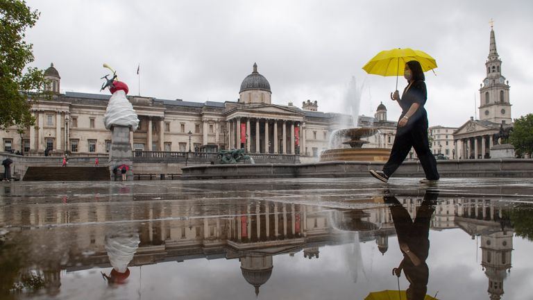 A woman shelters from the rain under an umbrella as she walks through Trafalgar Square, London, as many parts of the UK experience wet weather ahead of the arrival of Storm Ellen, which is forecast to bring strong winds.