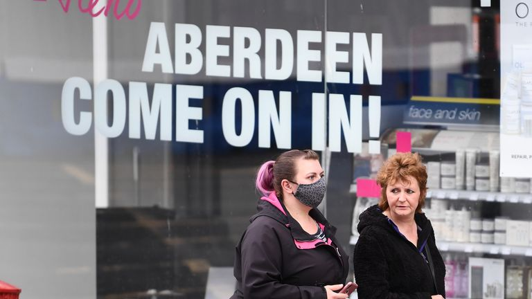 ABERDEEN, SCOTLAND - AUGUST 05: Two woman walk past closed shops on August 5, 2020 in Aberdeen, Scotland. Scotland's First Minister Nicola Sturgeon acted swiftly and put Aberdeen back into lockdown after cases of Coronavirus in the city doubled in a day to 54. She ordered all indoor and outdoor hospitality venues to close by 5pm. (Photo by Jeff J Mitchell/Getty Images)