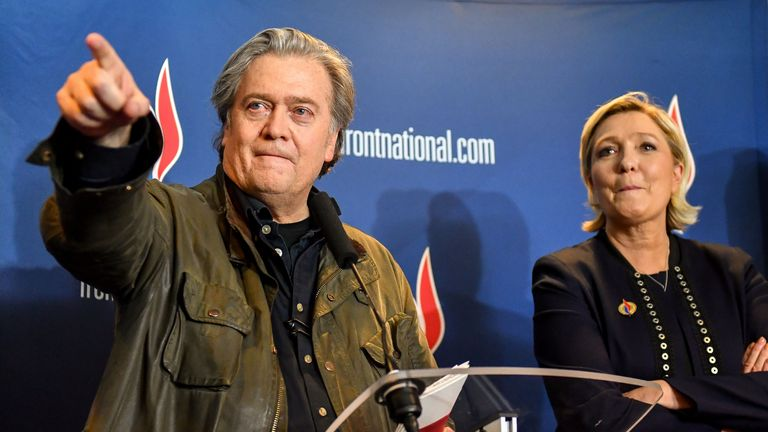 Former US President advisor Steve Bannon (L) gestures as he stands next to France's far-right party Front National (FN) president Marine Le Pen after giving a speech during the Front National party annual congress, on March 10, 2018 at the Grand Palais in Lille, northern France. / AFP PHOTO / PHILIPPE HUGUEN        (Photo credit should read PHILIPPE HUGUEN/AFP via Getty Images)