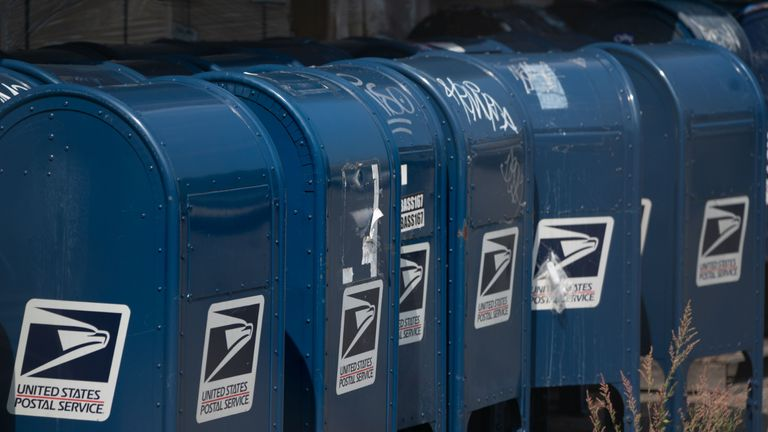 Mail boxes sit in the parking lot of a post office in the Borough of the Bronx on August 17, 2020 in New York. - The United States Postal Service is popularly known for delivering mail despite snow, rain or heat, but it faces a new foe in President Donald Trump. Ahead of the November 3 elections in which millions of voters are expected to cast ballots by mail due to the coronavirus, Trump has leveled an unprecedented attack at the USPS, opposing efforts to give the cash-strapped agency more money as part of a big new virus-related stimulus package, even as changes there have caused delays in mail delivery. (Photo by Bryan R. Smith / AFP) (Photo by BRYAN R. SMITH/AFP via Getty Images)