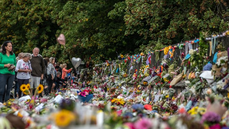 CHRISTCHURCH, NEW ZEALAND - MARCH 19: People view flowers and tributes by the botanical gardens on March 19, 2019 in Christchurch, New Zealand. 50 people were killed, and dozens are still injured in hospital after a gunman opened fire on two Christchurch mosques on Friday, 15 March.  The accused attacker, 28-year-old Australian, Brenton Tarrant, has been charged with murder and remanded in custody until April 5. The attack is the worst mass shooting in New Zealand's history. (Photo by Carl Court/Getty Images)