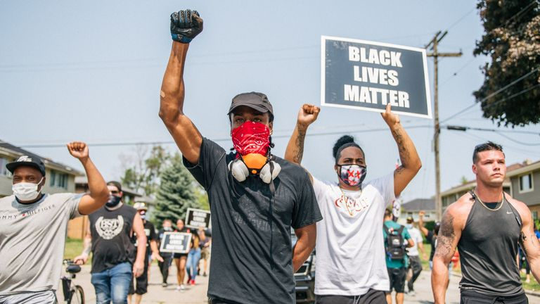 KENOSHA, WI - AUGUST 24: Demonstrators participate in a march on August 24, 2020 in Kenosha, Wisconsin. A night of civil unrest occurred after the shooting of Jacob Blake, 29, on August 23. Blake was shot multiple times in the back by Wisconsin police officers after attempting to enter into the drivers side of a vehicle. (Photo by Brandon Bell/Getty Images)
