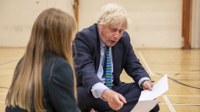 Prime Minister Boris Johnson in the gym taking part in a getting to know you induction session with year sevens as he tours Castle Rock school, Coalville, in the east Midlands.