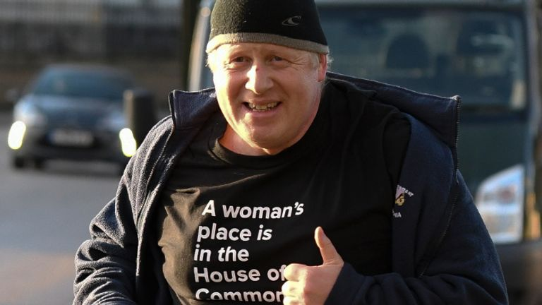 Celebrity Fitness: LONDON, ENGLAND - MARCH 08: British International Secretary Boris Johnson takes an early morning scamper on Global Ladies's Day carrying a T-shirt announcing