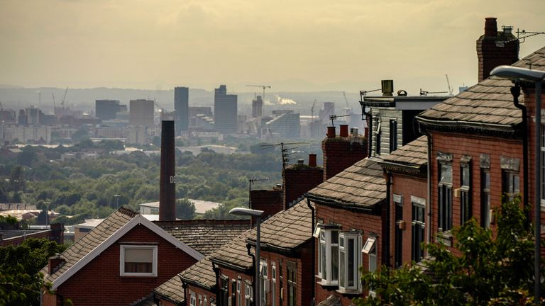 OLDHAM, ENGLAND - JULY 29: A general view of an old cotton mill in Oldham with the city of Manchester on the horizon on July 29, 2020 in Oldham, England. Oldham Council is taking preventative measures to prevent a local lockdown during the coronavirus pandemic. The Greater Manchester town has become England's second highest Covid-19 infection rate, after Blackburn with Darwen, and is currently showing a Covid-19 infection rate of 54.3 cases per 100,000 people.  (Photo by Christopher Furlong/Getty Images)