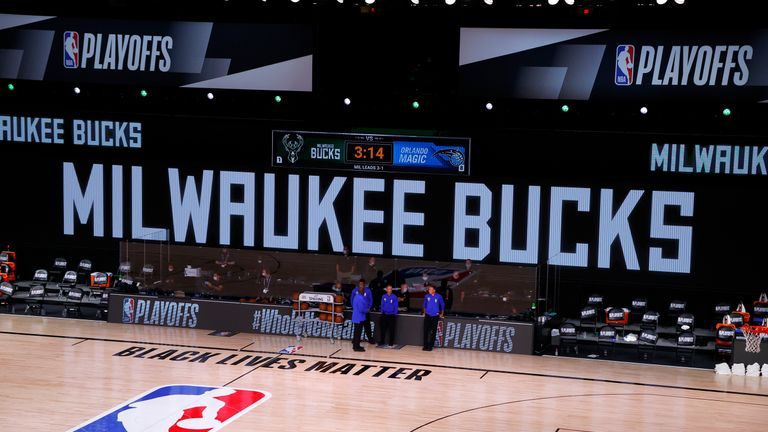 LAKE BUENA VISTA, FLORIDA - AUGUST 26: Referees stand on an empty court before the start of a scheduled game between the Milwaukee Bucks and the Orlando Magic for Game Five of the Eastern Conference First Round during the 2020 NBA Playoffs at AdventHealth Arena at ESPN Wide World Of Sports Complex on August 26, 2020 in Lake Buena Vista, Florida. NOTE TO USER: User expressly acknowledges and agrees that, by downloading and or using this photograph, User is consenting to the terms and conditions of the Getty Images License Agreement. (Photo by Kevin C. Cox/Getty Images)
