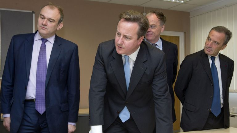 (left to right) Energy Secretary Ed Davey, Prime Minister David Cameron, Vincent de Rivaz, Chief Executive of EDF (Electricite de France) and Henri Proglio, CEO and Chairman of EDF as they examine site plans for the news Hinkly C nuclear power station at Hinkley Point, Somerset. Britain's first new nuclear power station in a generation is to be built under the £16 billion project which will create thousands of new jobs.