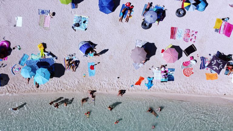 "An aerial picture shows crowds of people, including foreign tourists, enjoying the sun and the sea on August 21, 2020, in Split on the central Adriatic coast. - As United Kingdom removed Croatia from the list of ""safe countries"" to travel due to rising number of cases of COVID-19 throughout the country, many British tourists arrived at airport to return back to their country because of stricter measures when returning from Croatia. (Photo by Damir SENCAR / AFP) (Photo by DAMIR SENCAR/AFP via Getty Images)"