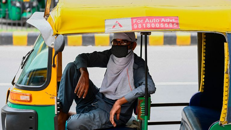 An auto rickshaw driver wearing a facemask as a preventive measure against the spread of the Covid-19 coronavirus, waits for passengers in New Delhi on August 30, 2020. - India on August 30 set a coronavirus record when it reported 78,761 new infections in 24 hours -- the world's highest single-day rise -- even as it continued to open up the economy. (Photo by Sajjad  HUSSAIN / AFP) (Photo by SAJJAD  HUSSAIN/AFP via Getty Images)