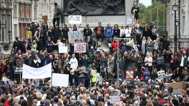 Anti-lockdown protesters, who believe that the coronavirus pandemic is a hoax, gather at the 'Unite For Freedom' rally in Trafalgar Square, London.