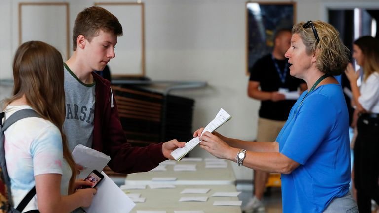 Sixth form students receive their A-Level results at The Hemel Hempstead School in Hemel Hempstead