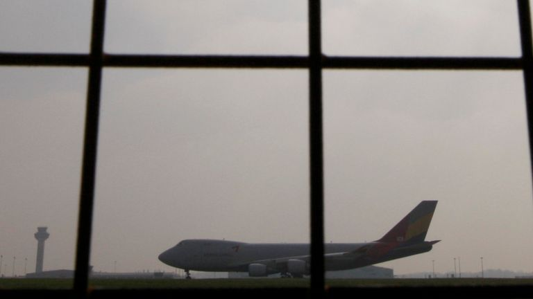 A passenger jet taxis along the runway at Stansted Airport in Essex