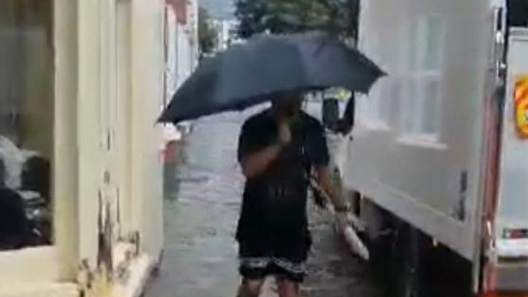 A man is seen wading down an Aberystwyth street
