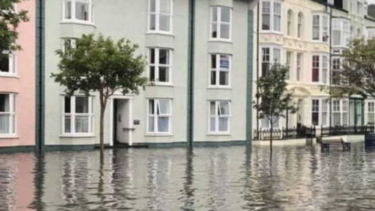 Roads were completely submerged by floodwater in Aberystwyth. Pic: Twitter/Tom Kendall