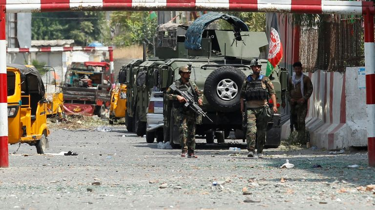 Afghan soldiers patrol the entrance to the prison in Jalalabad following the attack