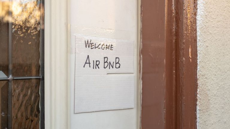 Close-up of hand drawn sign on door of a home reading Welcome AirBNB, indicating the home is made available for short term rental through the AirBNB website, Los Angeles, California, October 26, 2019. (Photo by Smith Collection/Gado/Getty Images)