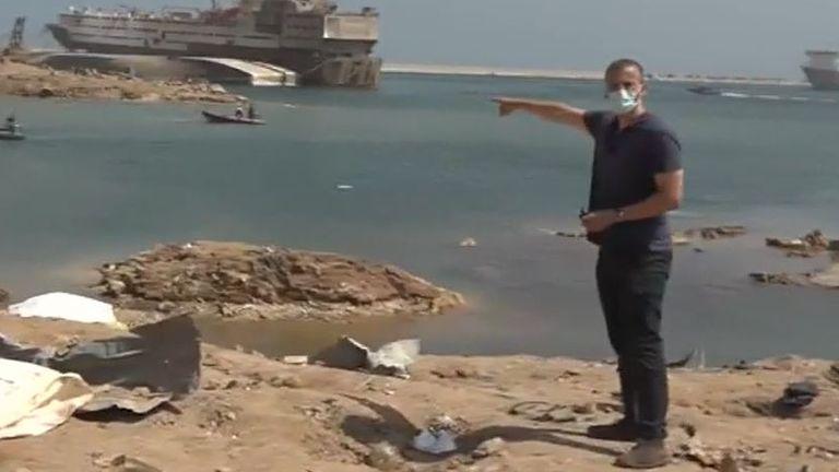 Alex Rossi walks around the explosion site in Beirut