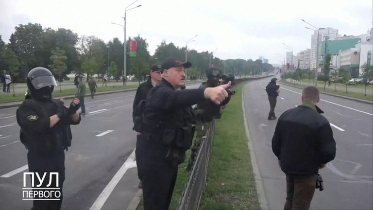 Alexander Lukashenko gives a thumbs up to security forces