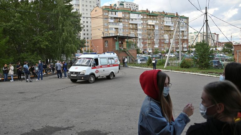 People gather outside a hospital, where Russian opposition leader Alexei Navalny receives medical treatment in Omsk, Russia August 21, 2020. Navalny was taken ill with suspected poisoning en route from Tomsk to Moscow on a plane, which made an emergency landing in Omsk. REUTERS/Alexey Malgavko