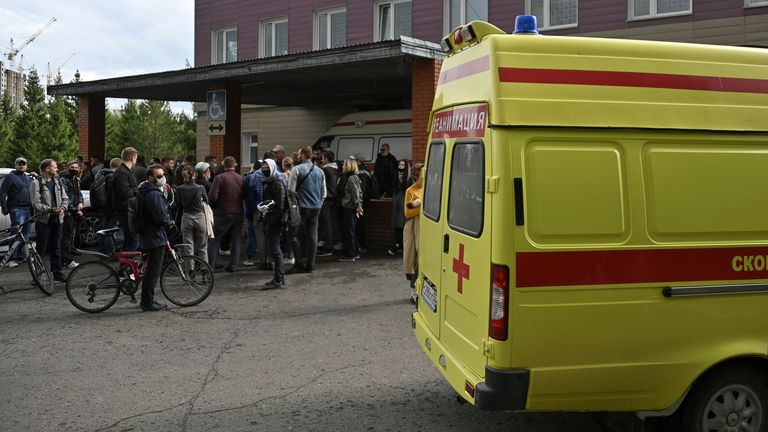 People gather outside a hospital, where Russian opposition leader Alexei Navalny receives medical treatment in Omsk