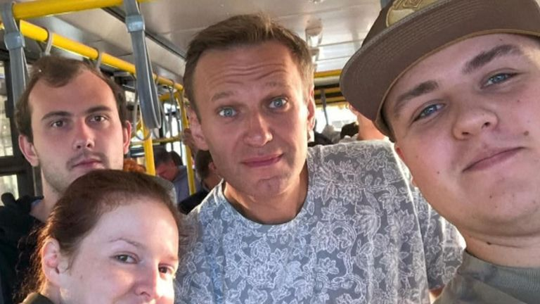 Alexei Navalny (centre) pictured in a selfie on a bus on the way to an airport in the Siberian city of Tomsk, before boarding a flight where he became unwell after allegedly being poisoned