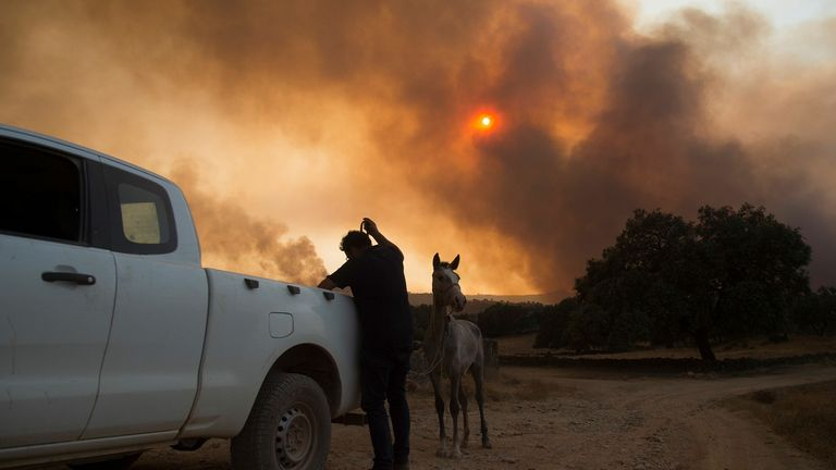 Smoke billows from a wildfire over El Buitron in Huelva, Andalusia