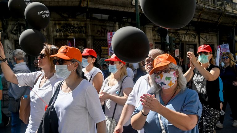 Health workers in Athens take part in a protest to call for the hiring of permanent frontline staff